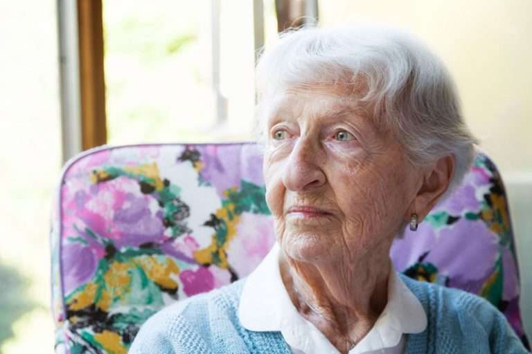senior-woman-looking-out-window